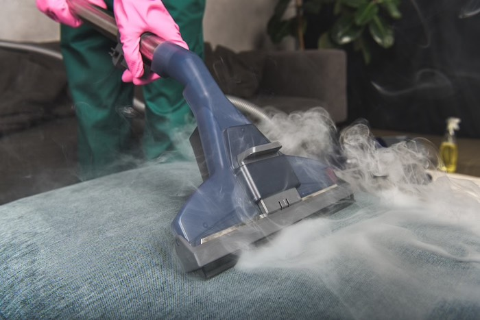 shot person cleaning sofa